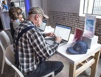 St Louis, Missouri, United States-March 27 2018-Old man, senior citizen using computer at Facebook Community Boost event. St Louis, Missouri, United States-March Stock Photo