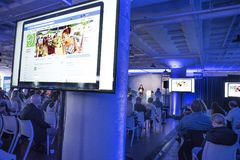 St Louis, Missouri, United States-March 27 2018-speaker and small business owners at Facebook Community Boost event video screens