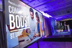 St Louis, Missouri, United States-March 27, 2018-Video screen and speaker at Facebook Community Boost event in St Louis. St Louis, Missouri, United States-March Royalty Free Stock Photo