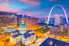 St. Louis, Missouri, USA Skyline. St. Louis, Missouri, USA downtown cityscape with the arch and courthouse at dusk royalty free stock images