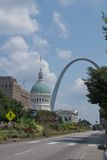 St. Louis Scene. A main street in downtown St. Louis, Missouri, with the landmark arch and capitol building in view Stock Photos