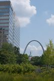St. Louis Scene. A modern office building seen through the trees of a local park, with the St. Louis Arch and Capitol building in the distance Royalty Free Stock Photo