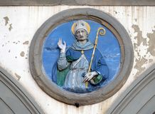 St. Louis of Toulouse, Ospedale di San Paolo in Florence. St. Louis of Toulouse, glazed terracotta tondo by Andrea della Robbia, located between two arches of stock photos