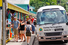 St. Lucia - Anse La Raye Souviner Shopping. A view of cruise tourists on an island taxi tour excursion shopping for local arts, crafts and souvenirs available at Stock Photography