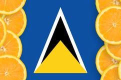 St Lucia flagga i vertikal ram för citrusfruktskivor arkivbilder