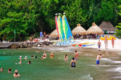 St. Lucia - Jalousie Beach Fun. Swimming, sailboats and other diversions await you with a fantastic view of the world famous Gros Piton from Jalousie Beach that stock photos