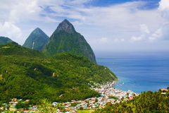 St. Lucia - The Pitons and Soufriere. A view of the world famous Pitons - Gros and Petit - overlooking the fishing town of Sourfriere on the southwest coast of