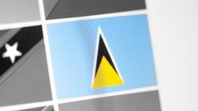 St. Lucia-Staatsflagge des Landes St. Lucia-Flagge auf der Anzeige, ein digitaler Wässerungseffekt lizenzfreie stockfotografie