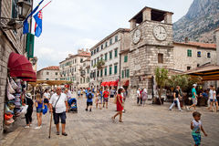 St. Luke`s Church on St. Luke`s square with tourists walkingin Kotor old town. Royalty Free Stock Photo