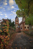 St. Lutwinus church and road with leaves in Mettlach Stock Photo