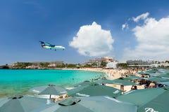 ST MAARTEN, CARIBBEAN - SEPTEMBER 21, 2013: airplane landing ove Royalty Free Stock Photography
