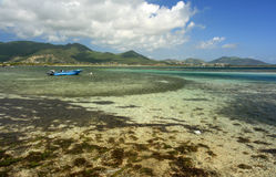 St Maarten - Clear Waters. A small boat floats in the waters off Coconut Grove,  St. Maarten Stock Photography