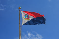 St. Maarten flag in blue sky. St. Marteen flag in the blue sky waving Stock Images