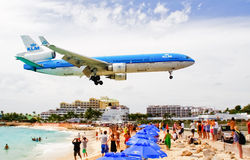 St. Maarten Maho Bay KLM Plane Landing. A KLM Royal Dutch Airlines flight flys over onlookers at Maho Bay beach as it arrives at Princess Juliana International