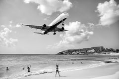 Beach observe low flying airplanes landing near Maho Beach. St Maarten, Netherlands - February 13, 2016: beach observe low flying airplanes landing near Maho Royalty Free Stock Image