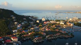 St Maartin Aerial. V34 Flying low over Simpson Bay Lagoon panning at sunrise stock video