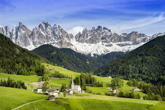 St. Magdalena or Santa Maddalena. With its characteristic church in front of the Geisler or Odle dolomites mountain peaks in the Val di Funes (Villnosstal) in stock image