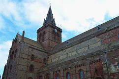 Ancient Saint Magnus cathedral in Kirkwall, Orkney archipelago, Scotland. St. Magnus Cathedral dominates the skyline of Kirkwall, the main town of Orkney, a Royalty Free Stock Image