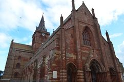 Ancient Saint Magnus cathedral in Kirkwall, Orkney archipelago, Scotland. St. Magnus Cathedral dominates the skyline of Kirkwall, the main town of Orkney, a Stock Images