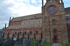 Ancient Saint Magnus cathedral in Kirkwall, Orkney archipelago, Scotland. St. Magnus Cathedral dominates the skyline of Kirkwall, the main town of Orkney, a Stock Photos