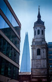 St. Magnus the Martyr Church spire with the London Shard. stock photo