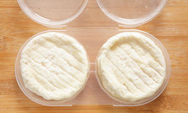 St Marcellin cheeses in container Stock Images