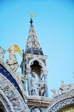 St. Mark`s basilica, part of the majestic facade, in Venice, Italy. St. Mark`s basilica, details of the sculptures, on the majestic facade, in Venice, Italy Royalty Free Stock Photos