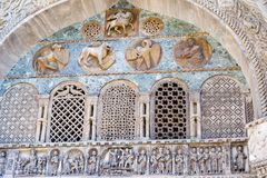 Intricate stone carvings on North Portal, West Facade of St. Mark's Basilica, Venice. Stone carvins of the North Portal, West Facade (Porta di Sant&# Royalty Free Stock Photography