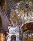 Vertical slice of St. Mark`s Basilica of vaulting, nave & transept. St Mark`s Basilica in Venice is one of the finest examples of Byzantine architecture in the Royalty Free Stock Photos
