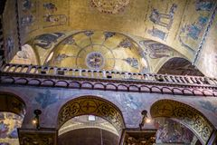 Inside St. Mark`s Basilica of vaulting, nave & transept. St Mark`s Basilica in Venice is one of the finest examples of Byzantine architecture in the world Royalty Free Stock Photography