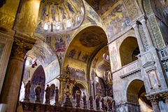 Inside St. Mark`s Basilica of vaulting, nave & transept. St Mark`s Basilica in Venice is one of the finest examples of Byzantine architecture in the world Stock Photography