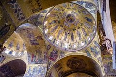 Inside ceiling mosaics of the vaulting, naves & transept of St. Mark`s Basilica in Venice. St Mark`s Basilica in Venice is one of the finest examples of Stock Photography