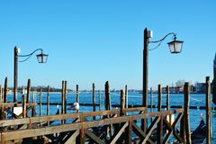 St Mark`s basin and wooden poles, in Venice, Italy Stock Photos