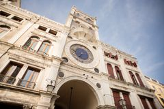 St Mark`s Clock Tower in Venice on Piazza San Marco. Stock Photo