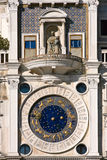 St. Mark's square clock tower in Venice Stock Images