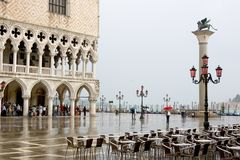 St Mark's Square, Piazzetta and rain. St Mark's Square is the principal public square of Venice, Italy. It is dominated at its eastern end by the great church of Royalty Free Stock Photography