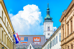 St. Mark's square in Zagreb, Croatia. View at upper town of Zagreb, main national church roof with croatian emblems  and flag on St. Mark's square in Croatia Royalty Free Stock Photo