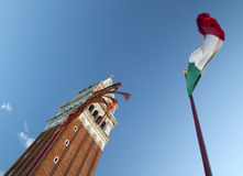 St Mark's Tower With Flags Venice. St. Mark´s Tower With Flags. Venice, Italy Royalty Free Stock Image