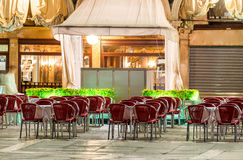 St Mark Square at night in Venice. Outdoor restaurant seats Royalty Free Stock Images