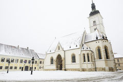 St. Marks' church in Zagreb, Croatia. During a snowstorm. The church is one of the oldest buildings in Zagreb, built in the 14th century, but rebuilt and Stock Image