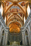 St.Martin Church in Italy. The interior, golden paintings on the ceiling Stock Images