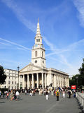 St Martin In The Fields. London, UK - September 1, 2010:  St Martin In The Fields in the north east corner of Trafalgar Square with tourists in the foreground Stock Image