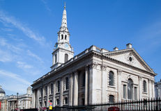 St Martin-in-the-Fields Church London England. The facade of St Martin-in-the-Fields Church with its long clock tower in Trafalgar Square, London, England Royalty Free Stock Photography