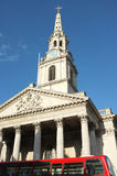 St Martin in the Fields Church, London. The Church of St Martin in the Fields in Trafalgar Square in London with the top of an iconic red london bus.  It is an Royalty Free Stock Photography