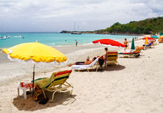 St Martin Friars Bay Beach. The Caribbean Sea, beach chairs, umbrellas and lots of sand and sun await at secluded Friars Bay beach in amazing St. Martin Stock Images