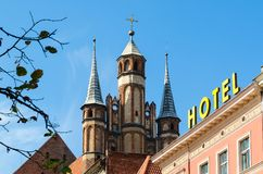 St. Mary's Church in Torun, Poland. Ornamental turrets of the most commanding gothic building in Torun City, listed by UNESCO organisation Stock Photo