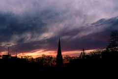 St. Mary Abbot's Church, Kensington. A silhouette of a church spire in central London, against an impressive sunset Stock Photography