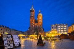St. Mary Basilica and the Krakow Cloth Hall at night. St. Mary Basilica on the Main Square at night, Poland Stock Photos