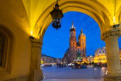 St. Mary Basilica view from the Krakow Cloth Hall. At dusk, Poland Royalty Free Stock Images
