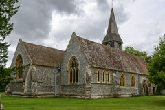 St. Mary church, Whitchurch on Thames. View of north side of ancient church in touristic village on river Thames, shot under cloudy yet bright sky Stock Image